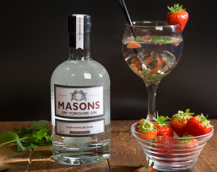Masons Slow Distilled Sloe Gin Bottle with Gin Glass and Strawberries